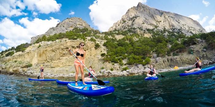 Катание на доске стоя с веслом SUP (Stand Up Paddleboard)